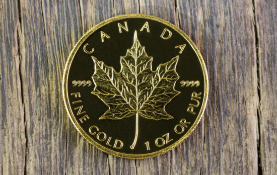 A Gold Canadian Maple Leaf coin.