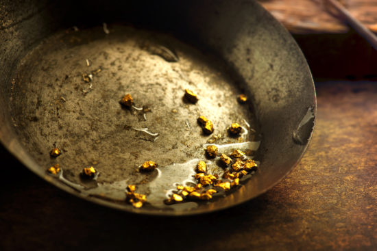 Gold in a gold pan.